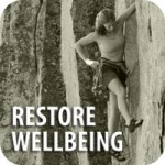 Restore wellbeing with photo of a woman wall-climbing with Restore Balance.